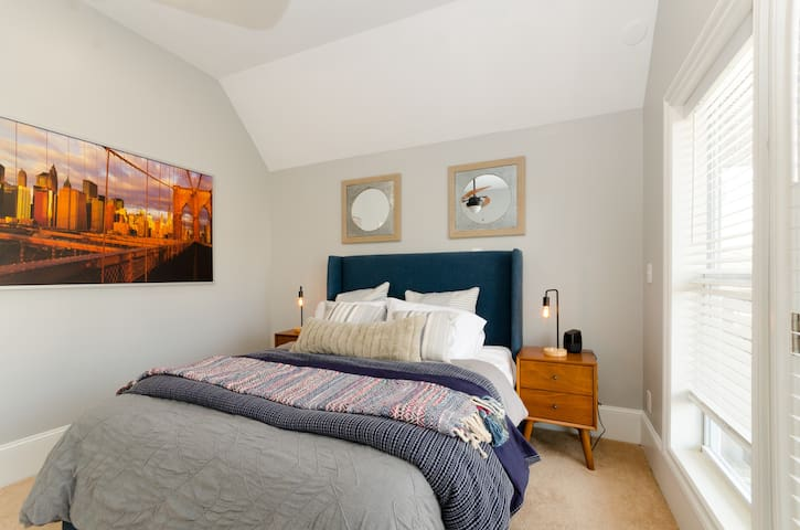 """East Atlanta bedroom - we've wall-mounted a 43"""" 4K TV in the corner. (not shown in picture)"""