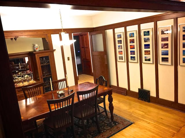 Huge dining room table with built-in art glass china cabinets.