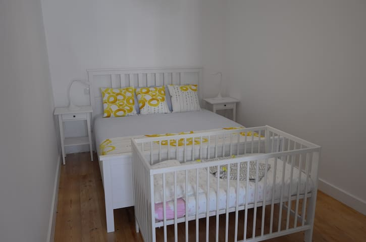 Bedroom 1 with a cot bed (upon request)
