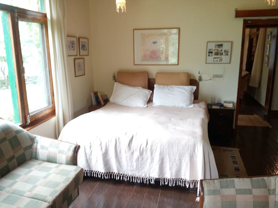 One of the two bedrooms. Apple trees visible from both windows in this room