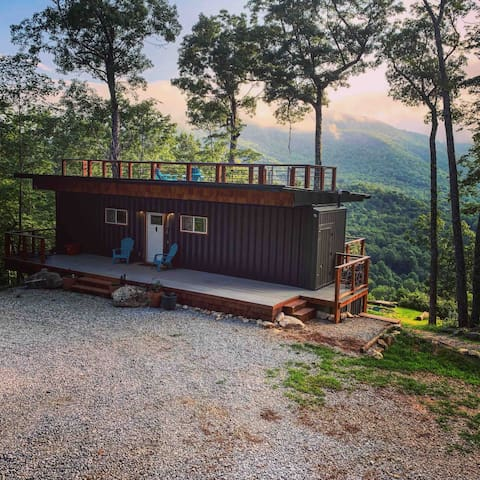 The front view of the Appalachian Mountain Container Cabin.  Check out that new 40 ft x 8 ft covered front deck!
