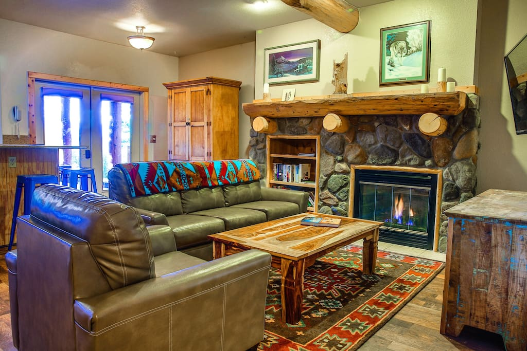 The Aspen Alley apartment with toasty fireplace, fully equipped kitchen, and mountain views.