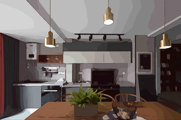 开放式厨房除集成灶 锅具 餐具等常规设备 还配备有蒸箱 烤箱