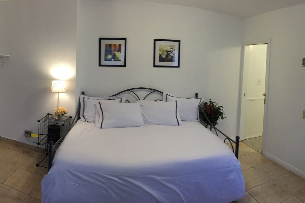 panoramic photo of the bed side of the studio unit