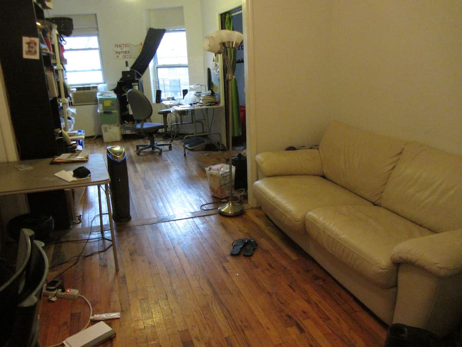 This is the living space with couch, connected to the room with a desk you can use