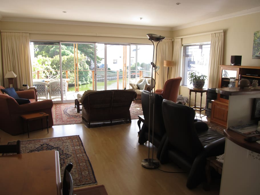Dining room table and lounge area on to deck with sliding doors