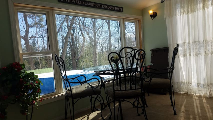 Sunroom with 3 ways view and good family room