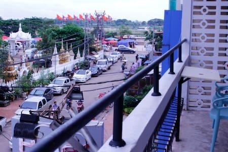 Mekong riverside with balcony .