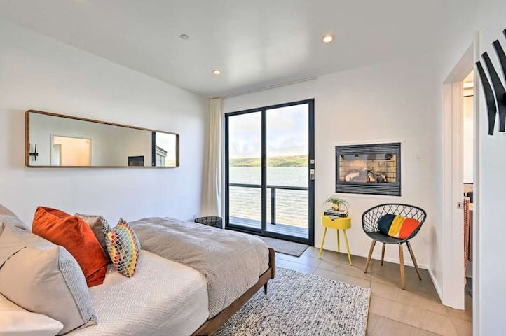 Master Bedroom on the Bay - Spectacular unobstructed bay views, large Fleetwood Sliding Door to over-water deck, in-wall gas fire, books, side table and thoughtful simplistic modern decor.