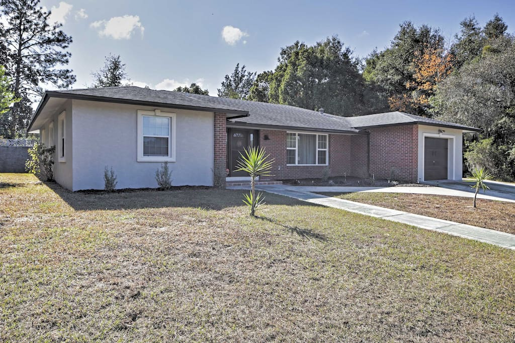 Enjoy the ultimate Florida getaway at this homey 4-bedroom, 2-bathroom house in Citrus Springs that comfortably sleeps 9 guests.