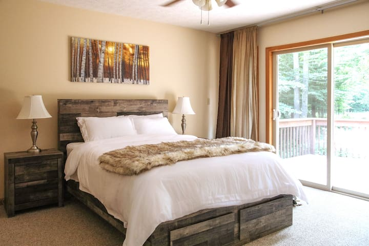 Retire to the master bedroom suite with a queen bed, its own private bathroom with a walk-in shower, walk-in closet and access to front deck!  A pack-n-play is available if needed.