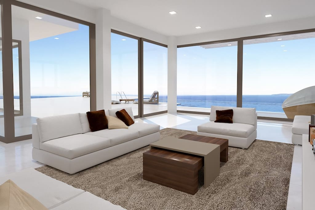 Sitting area: Clear design and the large openings take full advantage of the landscape, an elegant combination between the mountainous surrounding and the blue waves of the Ionian Sea.