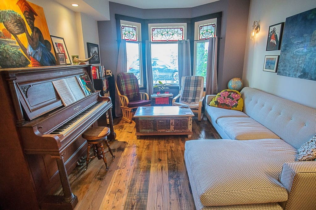 Original stained glass windows let through the perfect light for musicians to play the piano by!