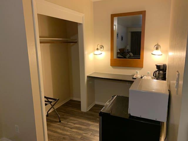 Spacious area with closet, mini-fridge, microwave, and coffeemaker.