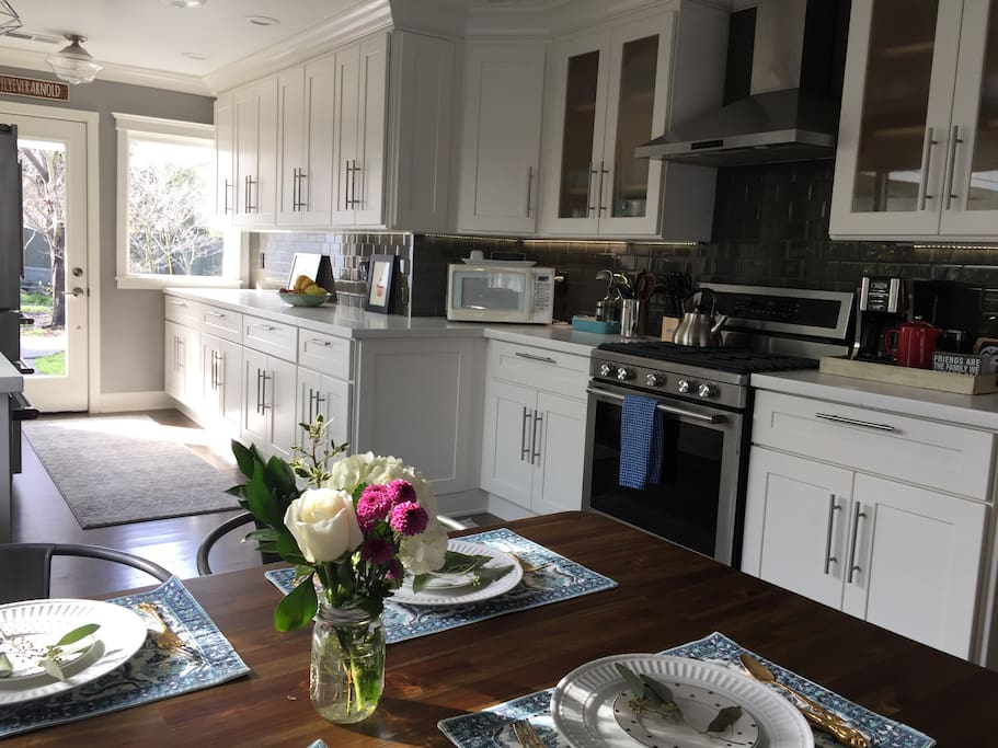 Kitchen has a gas stove, microwave, coffee and tea center and Bose speaker.