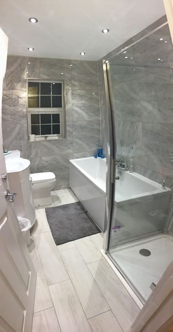 Shared family bathroom with bath and shower.  Shared with only one other room.