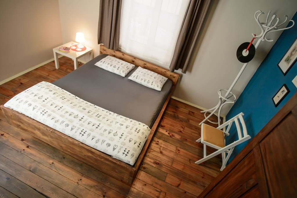 Handmade wooden bed in the Superior Double Room