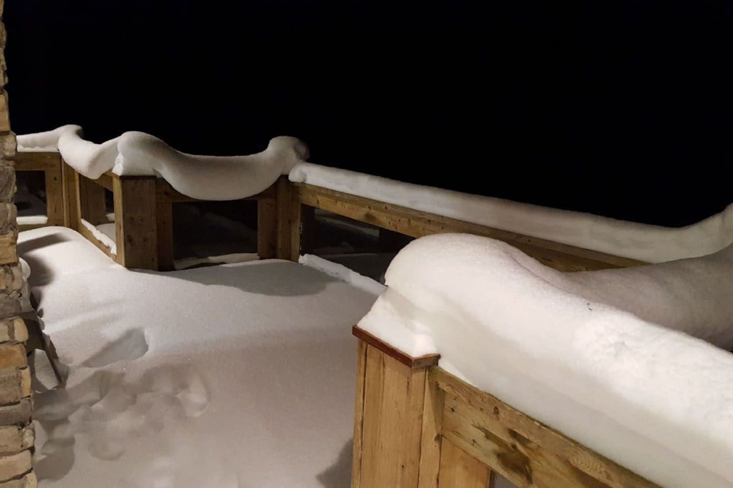 Heavy snowfall on front porch