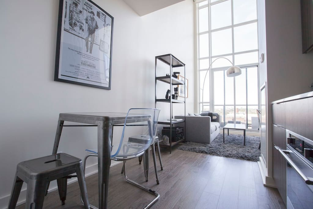 The loft has 2 floors, 17-foot-high ceilings, lots of natural light, and a great view of the city