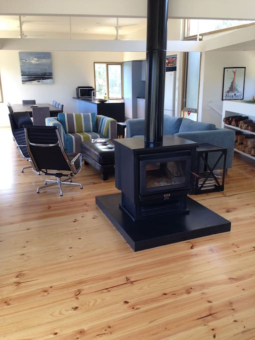 Open plan living space with wood fire