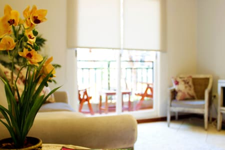Flora Apartments Orquidea