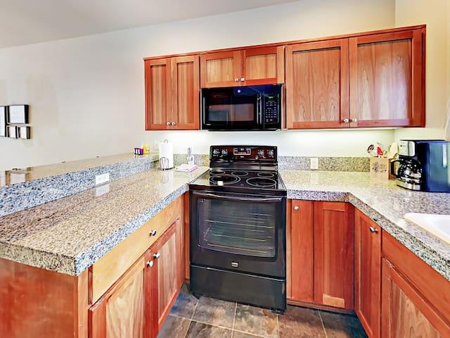 Granite countertops and contemporary appliances shine in the kitchen.