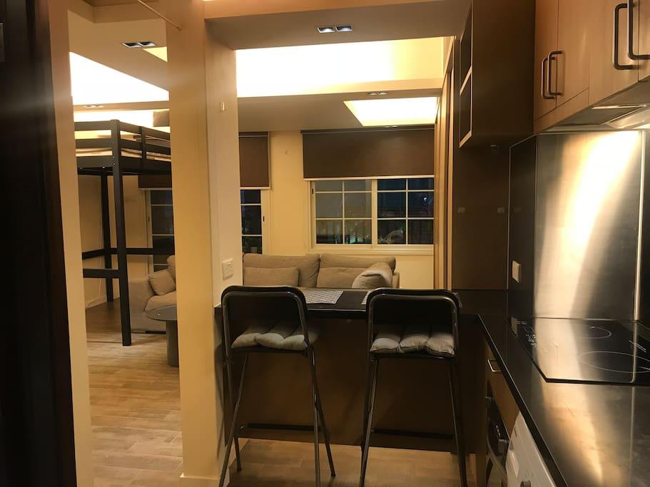 Spacious studio apartment with open bar