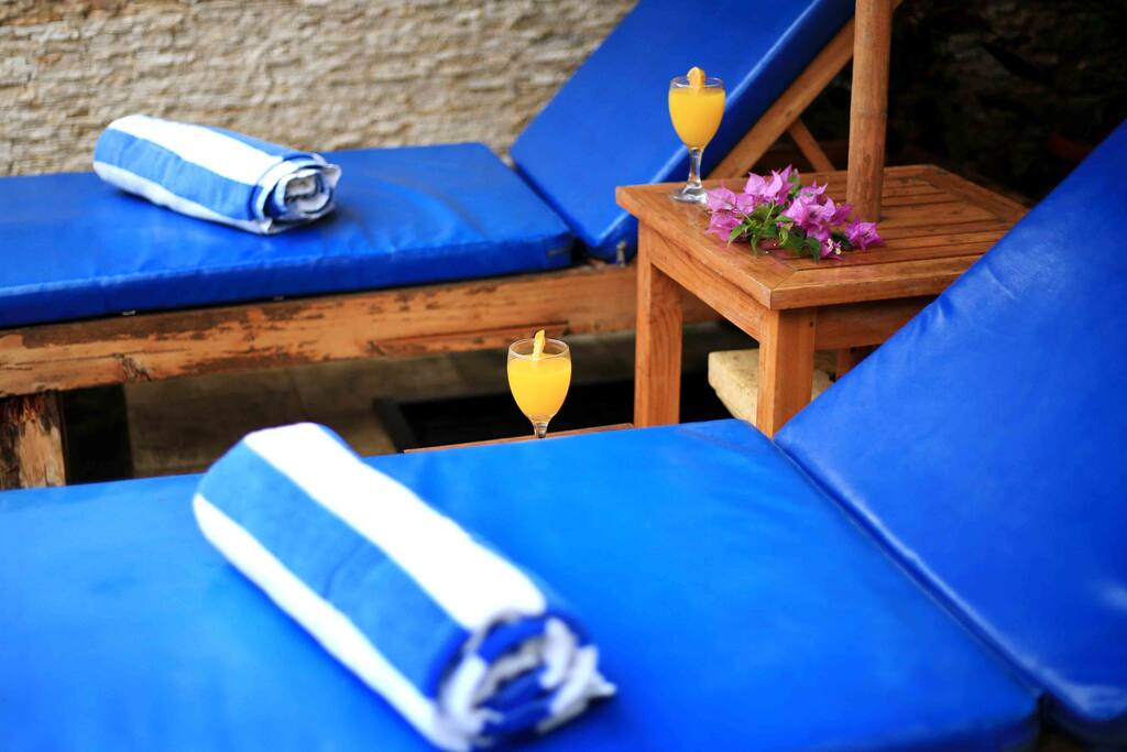 Pool reclining chairs with respective pool tiles.