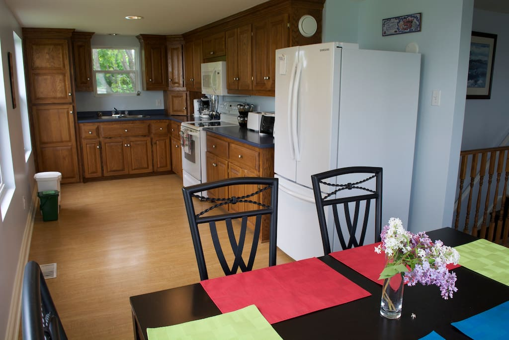 Well equipped kitchen with eat in dining area and views of the water
