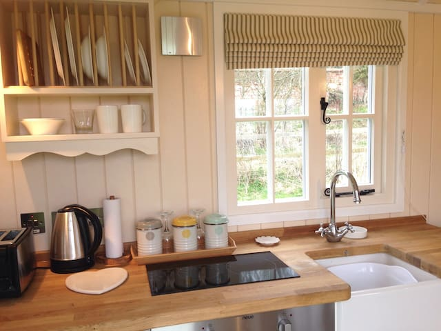 Kitchenette. Fully equipped with Belfast sink, full size under-counter fridge (with small freezer), oven, 2 ring hob, kettle and toaster.. Tea & coffee provided.