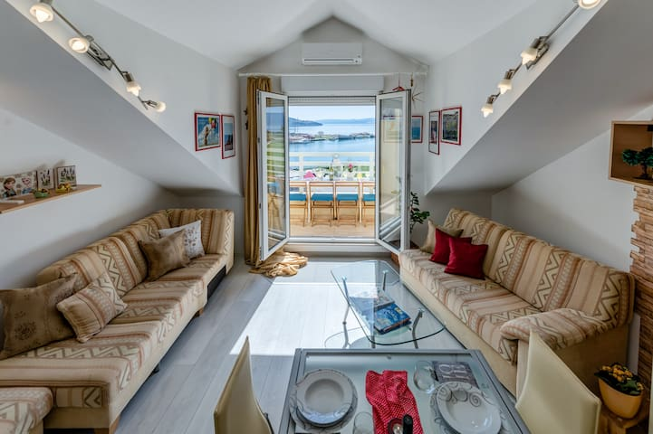 living room entrance to the terace. It is one open space. From a kitchen you have sea view, dining area on open space. Two large sofa, one can be additional bed 160x200cm.