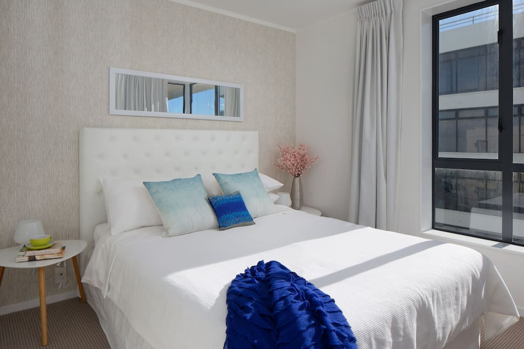 Relax in the tranquility of the master bedroom and sea view