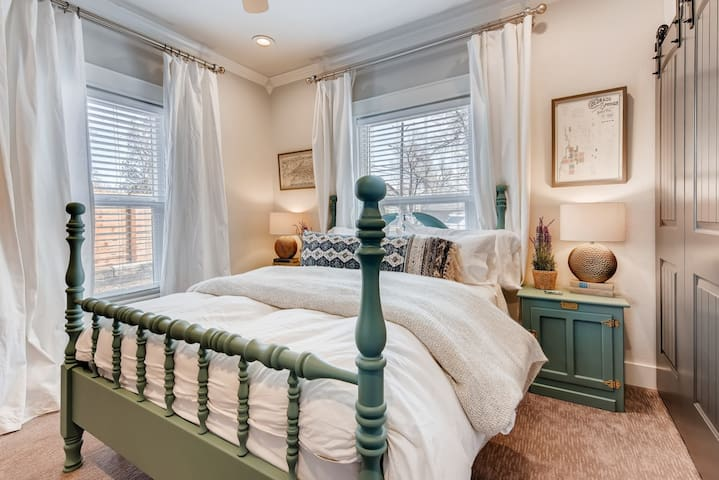 Enjoy a brand new comfy mattress, high quality bedding and fresh linens for your comfort. The master bedroom features a queen bed, blinds and curtains for sleeping in, a dresser, luggage rack, plenty of hangers, pack n play and fluffy robe.