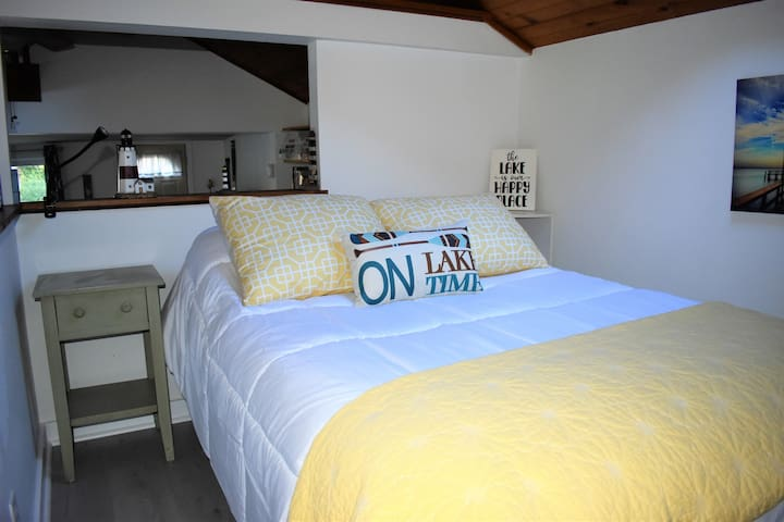 Loft style bedroom with double bed