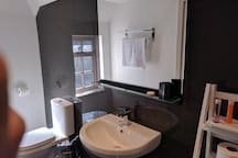 Large, modern, fully tiled bathroom,