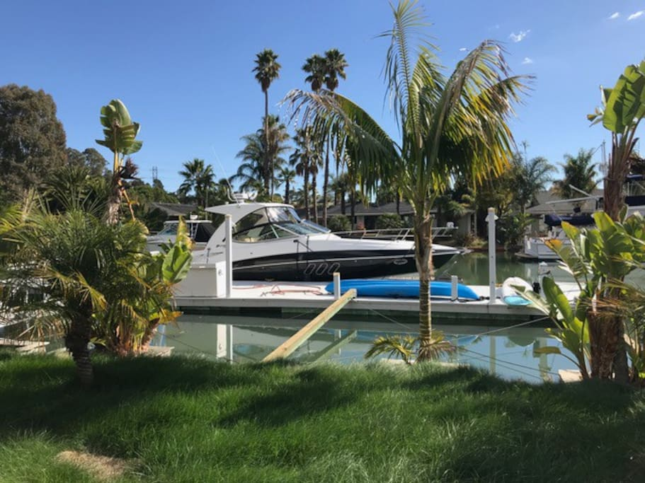 Backyard dock can accommodate 60' yacht. includes kayak and paddle boards for water play.