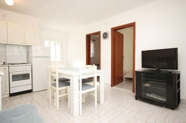 Two bedroom apartment with terrace and sea view Milna (Vis) (A-8895-b)