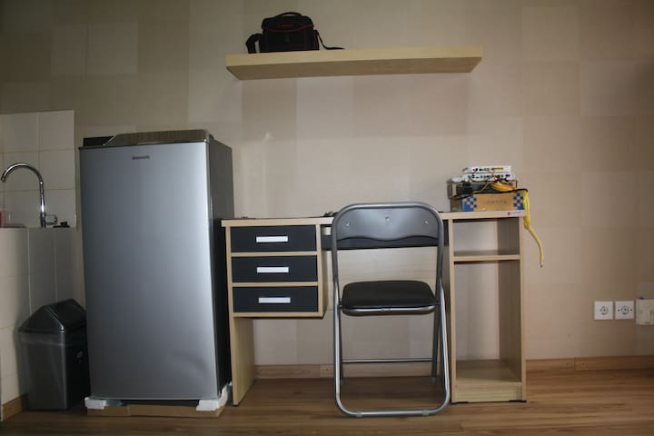Refrigerator, table, and chair