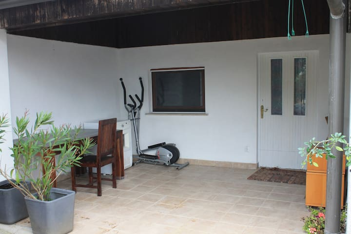 Private patio for guests' exclusive use, and front door leading to the independent apartment.