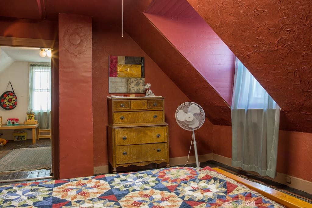 The double bed and one of the two dressers for guests in the large upstairs bedroom, Air conditioner unit in place, and plenty warm in winter!