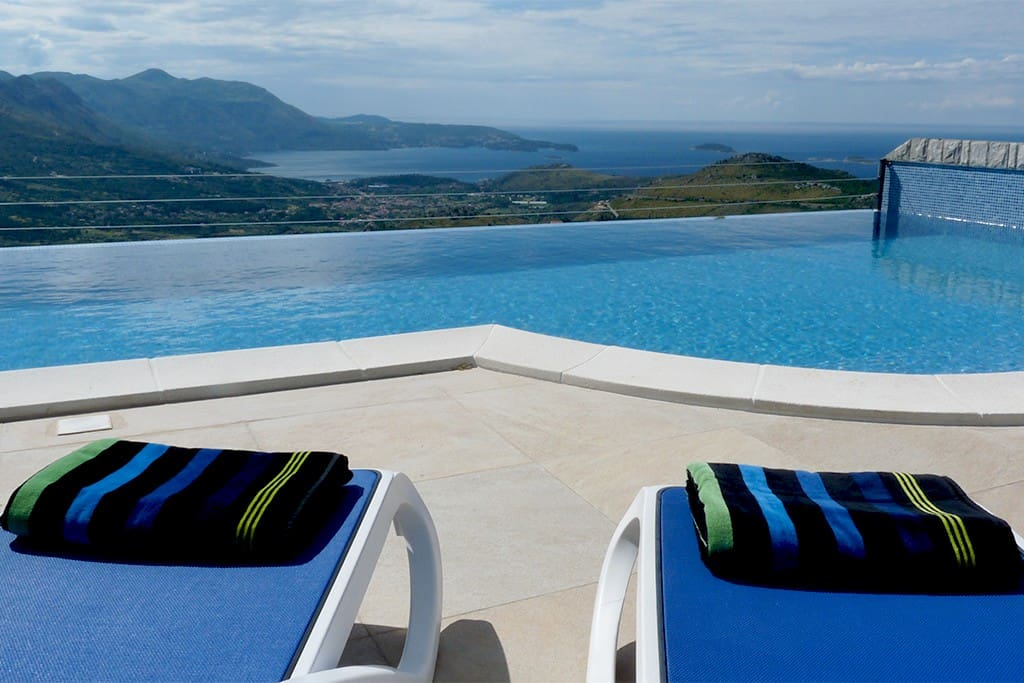 SUN LOUNGERS WITH COMPLIMENTARY POOL TOWELS FOR YOUR RELAXATION