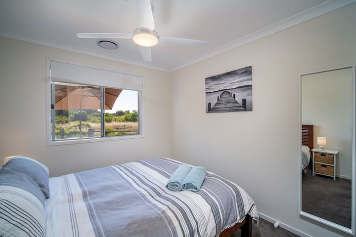 Bed 2 with Queen Bed, air conditioning, built in robe & full view of Edwards Point Reserve..