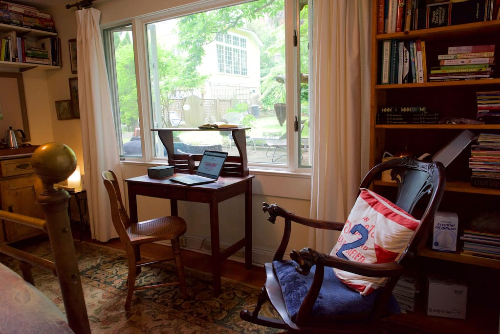computer/writing desk with a view of the garden.