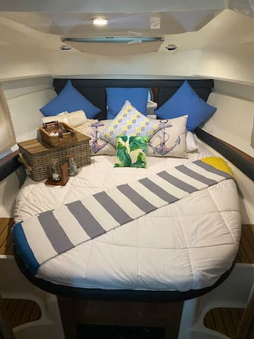 Master bedroom: Double bed with fresh sheets & pillows, small wardrobe with hangers, lights, electric socket, skylight, windows with curtains, AC