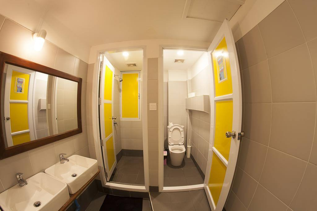 The bathroom is inside the room.