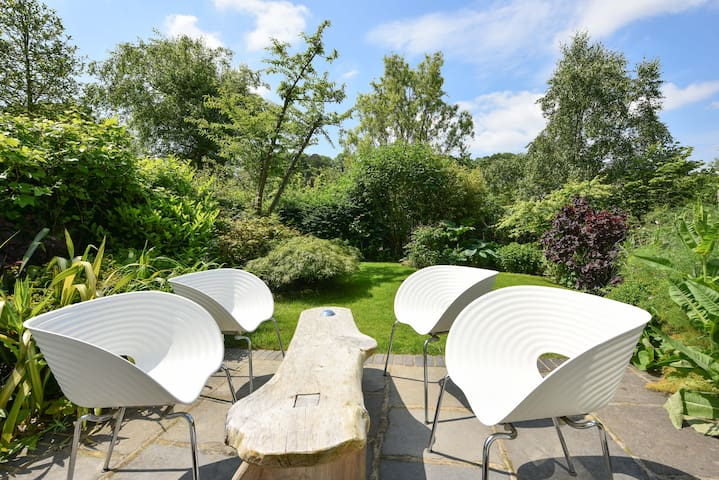 Designer garden chairs on the sun terrace. Perfect for breakfast through to a glass of wine in the evening.