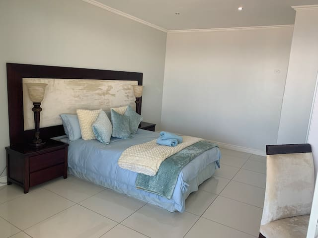 Airconditioned 2nd Bedroom with Queen Bed, and Dressing Table