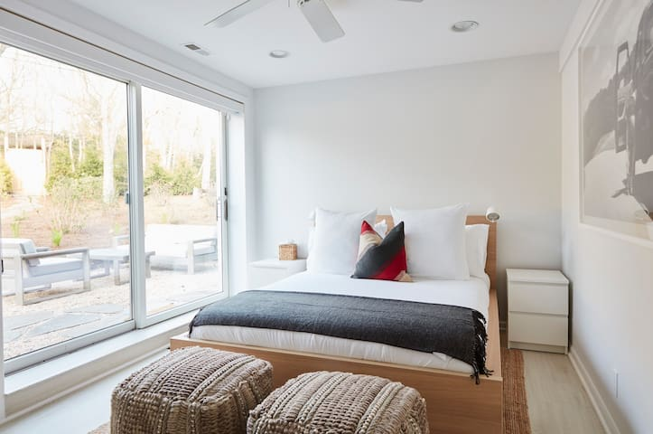 Queen guest bedroom 4. Downstairs with sliders that open onto patio + pool/spa deck. 55in smart tv & closet etc.