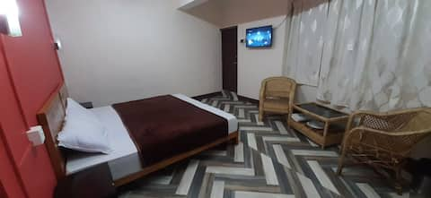 Executive Twin bed with sofa at Stay Abode