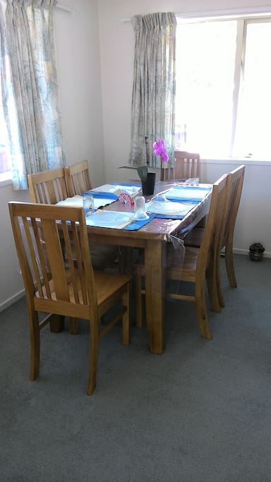 sunny dinning room with comfortable chairs